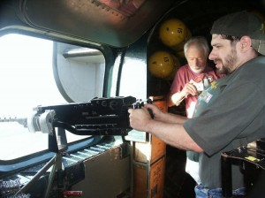 Eric M. Saperstein of Artisans of the Valley at the Waist gun of the last flying B-24 Liberator