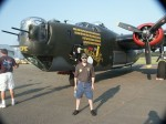 Eric M. Saperstein of Artisans of the Valley standing in front of the last flying B-24 Liberator