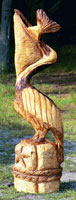 Artisans of the Valley feature Chainsaw Carving by Bob Eigenrauch - Pelican Swallowing a Fish