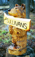 Artisans of the Valley feature Chainsaw Carving by Bob Eigenrauch - Bear with Namepate
