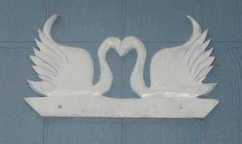 Hand carved swan applique